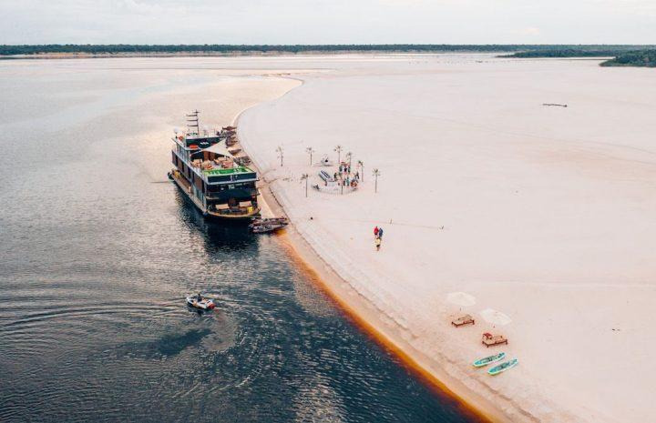 The Rio Negro Queen along the pristine white beaches in the Amazon